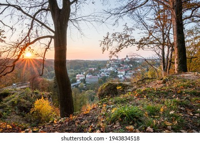 Nove Mesto nad Metuji, amazing small city in eastern Bohemia. Colorful evening view at sunset with sunrays in trees, view from Jurankova lookout at Vyrov ruin castle, Czech Republic - Shutterstock ID 1943834518