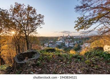 Nove Mesto nad Metuji, amazing small city in eastern Bohemia. Colorful evening view at sunset with sunrays in trees, view from Jurankova lookout at Vyrov ruin castle, Czech Republic - Shutterstock ID 1943834521