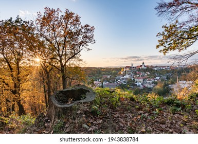 Nove Mesto nad Metuji, amazing small city in eastern Bohemia. Colorful evening view at sunset with sunrays in trees, view from Jurankova lookout at Vyrov ruin castle, Czech Republic - Shutterstock ID 1943838784