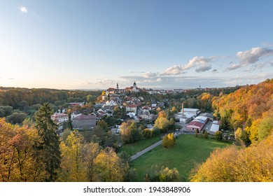 Nove Mesto nad Metuji, amazing small city in eastern Bohemia. View at sunset with colorful trees from Jurankova lookout at Vyrov ruin castle, Czech Republic - Shutterstock ID 1943848906
