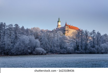 Nove Mesto nad Metuji, beautiful winter view of castle in snow at sunset, frozen trees and nice blue sky, Czech Republic - Shutterstock ID 1623108436