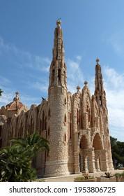 Novelda, Alicante, Spain - June 1 2017 - Sanctuary of Santa María Magdalena, Novelda on a sunny day. This church is designed by Jose Sala Sala, a pupil of Gaudi