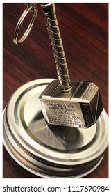 Novelty of Mjolnir, Thor's hammer. The inscription is in English; however, it is upside down. It reads: Whosoever holds this hammer, if he be worthy, shall possess the power of Thor.