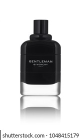 A novelty of perfume in 2018, a new fragrance from Givenci: Gentleman Givenchy Paris, 100 ml. Gentleman Eau de Parfume Givenchy cologne for men. Perfume black bottle isolated on white background