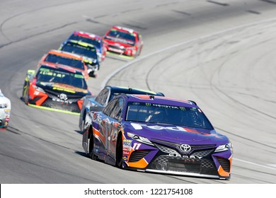 November 04, 2018 - Ft. Worth, Texas, USA: Denny Hamlin (11) Races through the field off turn four at the AAA Texas 500 at Texas Motor Speedway in Ft. Worth, Texas.