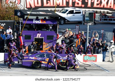 November 04, 2018 - Ft. Worth, Texas, USA: Denny Hamlin (11) comes down pit road for service during the AAA Texas 500 at Texas Motor Speedway in Ft. Worth, Texas.