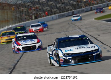 November 04, 2018 - Ft. Worth, Texas, USA: Kyle Larson (42) battles through the turns for position during the AAA Texas 500 at Texas Motor Speedway in Ft. Worth, Texas.