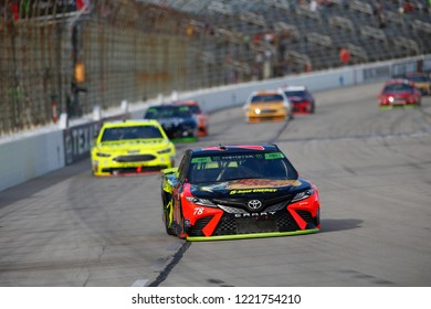 November 04, 2018 - Ft. Worth, Texas, USA: Martin Truex, Jr (78) battles through the turns for position during the AAA Texas 500 at Texas Motor Speedway in Ft. Worth, Texas.