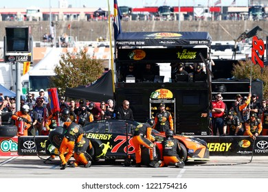 November 04, 2018 - Ft. Worth, Texas, USA: Martin Truex, Jr (78) comes down pit road for service during the AAA Texas 500 at Texas Motor Speedway in Ft. Worth, Texas.