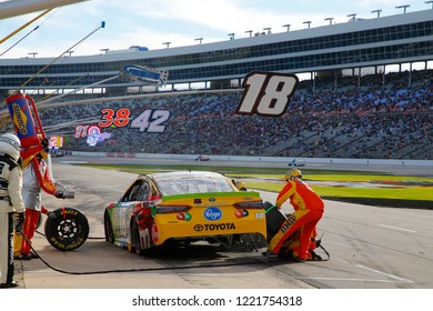 November 04, 2018 - Ft. Worth, Texas, USA: Kyle Busch (18) brings his car down pit road for service during the AAA Texas 500 at Texas Motor Speedway in Ft. Worth, Texas.
