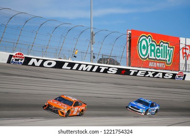 November 04, 2018 - Ft. Worth, Texas, USA: Daniel Suarez (19) races during the AAA Texas 500 at Texas Motor Speedway in Ft. Worth, Texas.