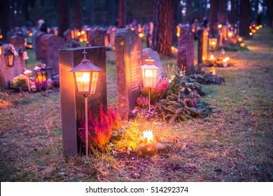 November 05, 2016: The lights on the graves of Skogskyrkogarden graveyard in Stockholm, Sweden on All Saints Day (deliberate low exposure for a dark and gloomy feel)