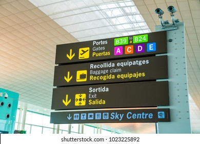 November 10, 2017. Barcelona. Spain. Airport departure and baggage claim signs in english and Spanish.