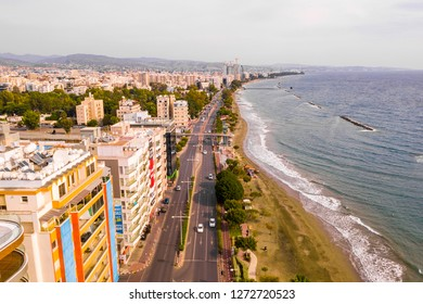 November 10, 2018, Limassol, Cyprus. Aerial view of Molos Promenade park on coast of Limassol city centre,Cyprus. Bird's eye view of the beachfront walk path and palm trees, Mediterranean sea