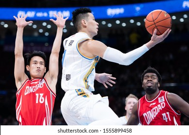 November 10, 2019 - Beijing, China: Former NBA player Jeremy Lin drives to the basket during a CBA game between Beijing Shougang Ducks and Qingdao Eagles in Cadillac arena.