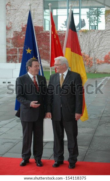 NOVEMBER 11, 2005 - BERLIN: Chancellor Gerhard Schroeder, Frank Steinmeier wait for a the chinese President to arrive at the Chanclery in Berlin.
