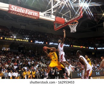 NOVEMBER 11 - PHILADELPHIA: Temple Owls guard Josh Brown (1) tries to block a shot by a Golden Flash guard during the NCAA basketball game against Kent State November 11, 2013 in Philadelphia