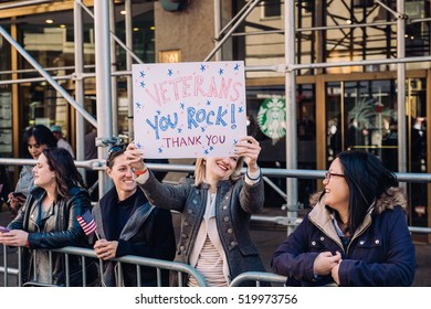 November 11th 2016 - New York City - At the Veterans Day Parade in NYC, a spectator holds a thank you sign.
