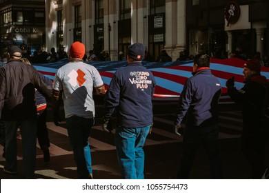November 11th 2017 - New York, NY - At the Veterans day parade, Soldiers and family members carry the flag that flew on the world trade center.