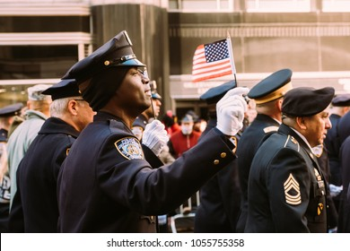 November 11th 2017 - New York, NY - At the Veterans day parade, an NYPD officer sings along to the national anthem.