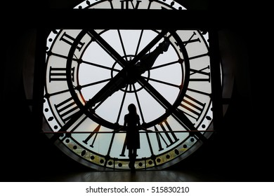 NOVEMBER 13, 2016 - PARIS: Woman silhouette standing in front of clock in the Orsay Museum, Paris, France