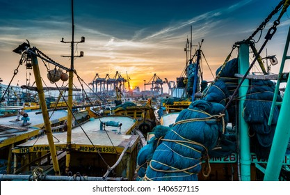 November 13,2018. Visakhapatnam,India. Fishing boats or Trawler with Fishing nets are standing on the port of Vizag at the time of Sunset.