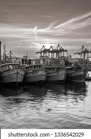 November 13,2018. Visakhapatnam,India. Monochrome image of Fishing boats or Trawler are standing on the port of Vizag at the time of Sunset.