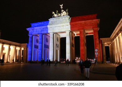 NOVEMBER 14, 2015 - BERLIN: the Brandenburg Gate in the colors of France -  mourning at the French Embassy in Berlin for the victims of the massacres in Paris of November 13, 2015.