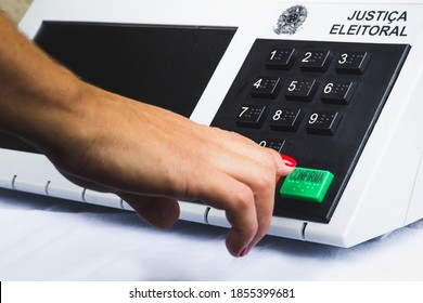 November 16, 2020, Brazil. In this photo illustration a woman simulates a vote in the electronic ballot box used in the elections of Brazil