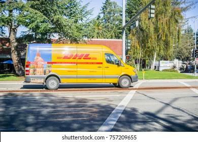 November 17, 2017 Sunnyvale/CA/USA - DHL van driving on the street, Silicon Valley, San Francisco bay area