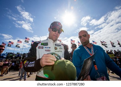 November 17, 2018 - Homestead, Florida, USA: Kevin Harvick (4) signs autographs on the way to his car to practice for the Ford 400 at Homestead-Miami Speedway in Homestead, Florida.