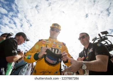 November 17, 2018 - Homestead, Florida, USA: Kyle Busch (18) signs autographs on the way to his car to practice for the Ford 400 at Homestead-Miami Speedway in Homestead, Florida.