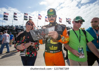November 17, 2018 - Homestead, Florida, USA: Martin Truex, Jr (78) signs autographs on the way to his car to practice for the Ford 400 at Homestead-Miami Speedway in Homestead, Florida.