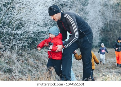 November 17, 2018 Logoisk Belarus Beetle-trail 8 LOGOISK Dad with his little son runs along the path near the forest