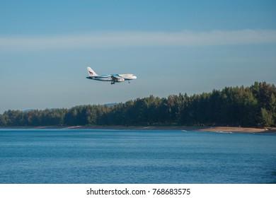November 18, 2017 Phuket Thailand -  Boeing 737 aircraft of Bangkok Airways (PG) is landing at Phuket International Airport.