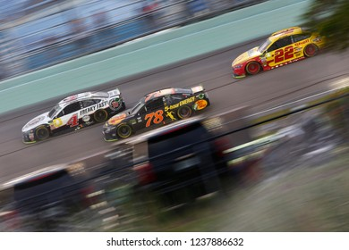 November 18, 2018 - Homestead, Florida, USA: Kevin Harvick (4), Martin Truex, Jr (78), and Joey Logano (22) battle for position during the Ford 400 at Homestead-Miami Speedway in Homestead, Florida.