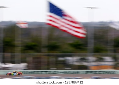 November 18, 2018 - Homestead, Florida, USA: Kyle Busch (18) races down the back stretch during  the Ford 400 at Homestead-Miami Speedway in Homestead, Florida.