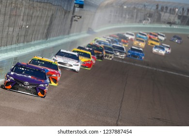 November 18, 2018 - Homestead, Florida, USA: Denny Hamlin (11) races down the front stretch during the Ford 400 at Homestead-Miami Speedway in Homestead, Florida.