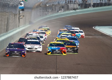 November 18, 2018 - Homestead, Florida, USA: Denny Hamlin (11) and Kyle Busch (18) lead the field down the front stretch during the Ford 400 at Homestead-Miami Speedway in Homestead, Florida.