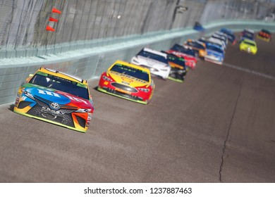 November 18, 2018 - Homestead, Florida, USA: Kyle Busch (18) races down the front stretch during  the Ford 400 at Homestead-Miami Speedway in Homestead, Florida.