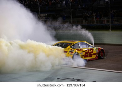 November 18, 2018 - Homestead, Florida, USA: Joey Logano (22) celebrates after winning the Monster Energy NASCAR Cup Series Championship after winning the Ford 400 at Homestead-Miami Speedway