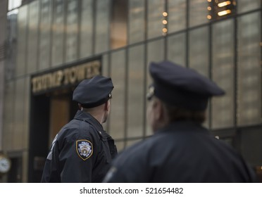 NOVEMBER 18TH 2016--NEW YORK CITY--Unidentified police officers from the NYPD keep watch outside Trump Tower, the US President elect, Donald Trump's HQ on 5th avenue in NYC.