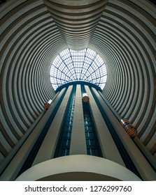 November 19th, 2018. Singapore, Singapore. Symmetrical atrium of a hotel in Singapore with elevators running down the middle.