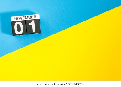 November 1st. Image of november 1 calendar on blue and yellow background. Empty space for text