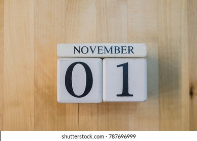 November 1st. Image of november 1 wooden color calendar on white brick wall background. empty space for text.