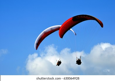 November 2 , 2014 .Paraglider flying in the sky. Paragliding. Two paragliders flying near clouds. Nantou City , Taiwan .