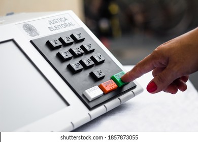 November 20, 2020, Brazil. In this photo illustration a woman simulates a vote in the electronic ballot box used in the elections of Brazil