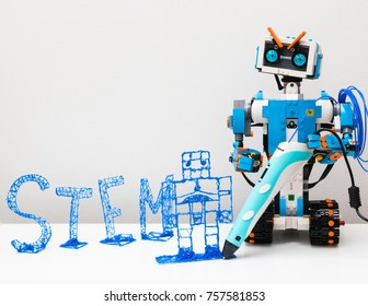 November, 2017. Minsk, Belarus.  Lego Boost Robot Vernie draws a robot 3d pen with a blue plastic handle. Robotics class for child and teen. Mathematics. Engineering. Technology. STEM education.