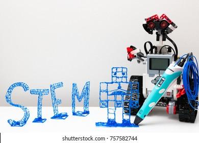 November, 2017. Minsk, Belarus.  Lego Mindstorms EV3 draws a robot 3d pen with a blue plastic handle. Robotics class for child and teen. Mathematics. Engineering. Technology. STEM education.