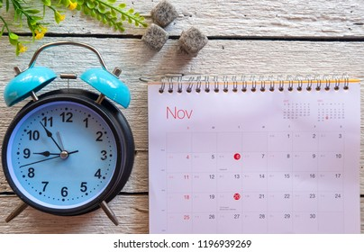 November 2018 calendar on white wooden background. Winter time and mood
